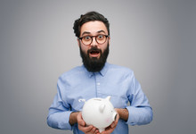 Content Man With Piggy Bank On...