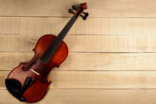 The Violin Lies On A Wooden Ta...