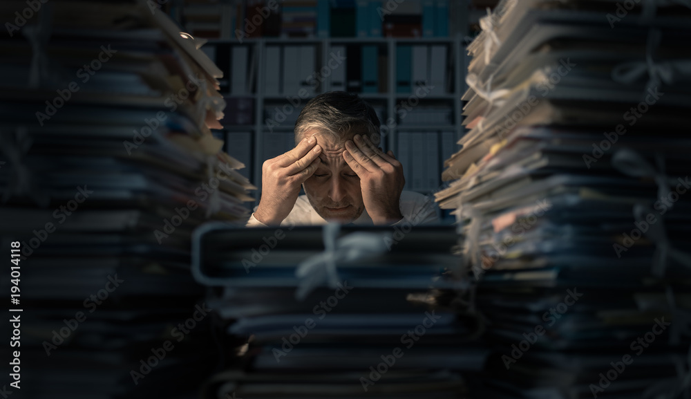 Fototapeta Desperate businessman working late