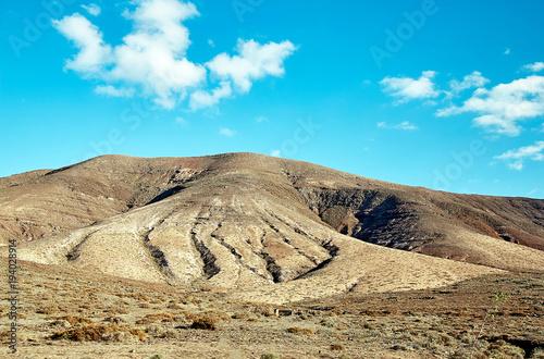 Deurstickers Canarische Eilanden Volcanic hills and blue sky
