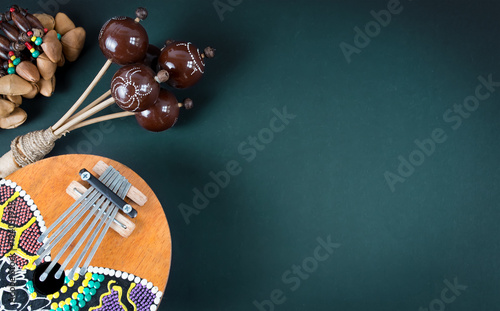 Wooden percussion instruments and kalimba on dark green background - 194031928