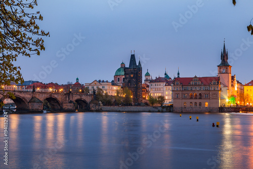 City on the water View of night old town of Prague and Charles bridge with reflection in Vltava River