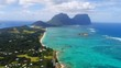 Aerial view of Lord Howe Island (World Heritage-listed paradise), turquoise blue lagoon and Mount Gower on background - New South Wales - Tasman Sea - Australia from above, 4k UHD