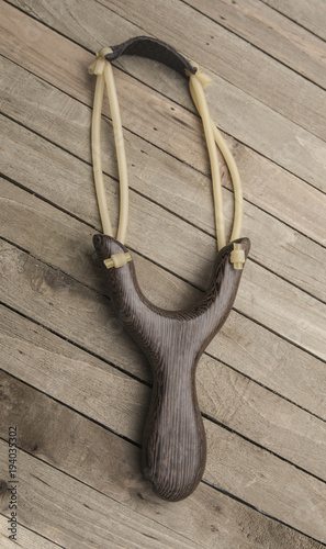 Modern Slingshot on a Wooden Table