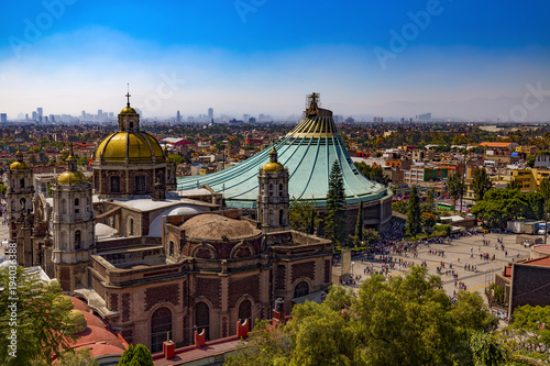 Mexico. Basilica of Our Lady of Guadalupe. The old and the new basilica, cityscape of Mexico City on the far
