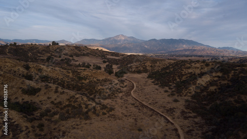 Aerial drone view of a landscape with desert and mountains