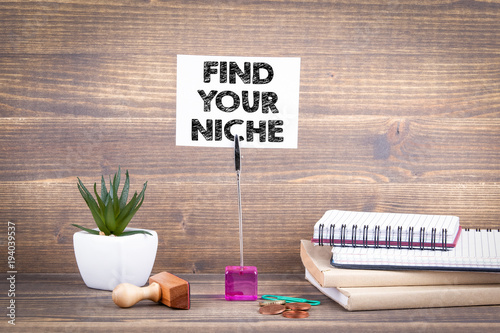 Find your niche. Wooden table with stationery. Wallpaper Mural