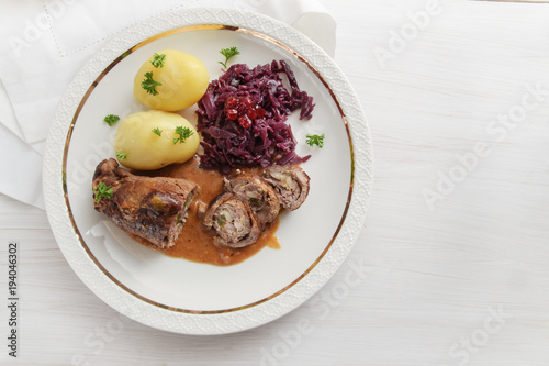 Fototapeta beef roll with red cabbage and potatoes, german meat roulade stuffed with cucumb