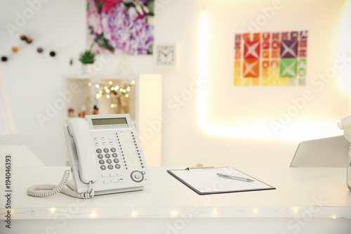 Telephone on reception desk in beauty salon