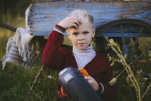 Portrait Of Boy Touching Hair ...