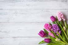 Wooden Background With A Bouquet Of Spring Flowers Tulips And Hyacinths