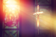 canvas print picture - crucifix, jesus on the cross in church with ray of light from stained glass