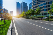 Modern Asphalt Road Through Modern City Skyline