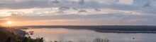 Large Panorama Of Sunset Over Lake Travis Texas With Sail Boat On The Side