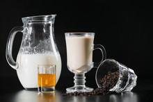 Black Tea Ans Milk Is From Jug...