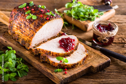 Photo  Roasted pork loin with cranberry and marjoram