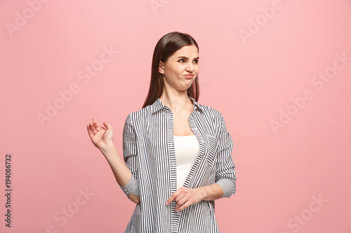 Fotografia, Obraz  Young woman with disgusted expression repulsing something, isolated on the pink