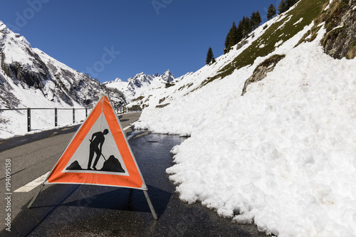 Warning sign because of a road blocked by a snow slide in the Alps Fototapeta