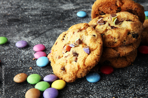 Fotobehang Koekjes Chocolate cookies with colorful candies. Chocolate chip smarties cookies.
