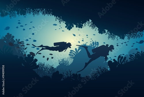 Fototapeta Silhouette of diver, coral reef and underwater cave on a blue sea background