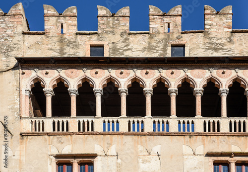 Fotografie, Obraz  Detail of the venetian gothic Loggia of the majestic Castle of Buonconsiglio at the heart of the city of Trento towers in Trentino Alto Adige, Italy