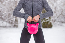 Woman Holding Pink Kettlebells At Winter Outdoors Concept
