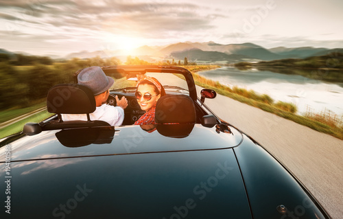 In love couple traveling by cabriolet car - 194101588