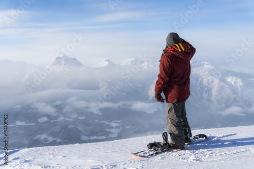 Snowboarder riding Revelstoke Mountain, British Columbia, Canada.