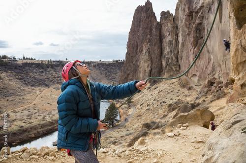 Woman is belaying her partner rock climbing Canvas Print
