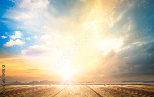 Obraz World environment day concept: Wooden table with sky autumn sunset background - fototapety do salonu