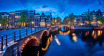 Bridge Blue hour arch over canal in Amsterdam Netherlands.