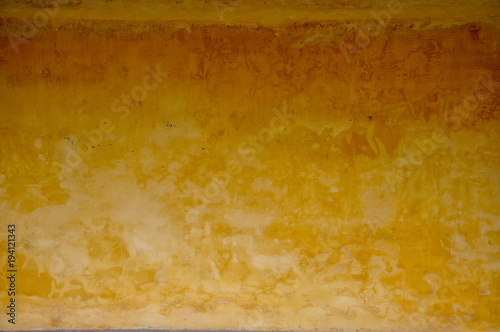 Foto op Canvas Weg in bos An old concrete wall in yellow color vintage style