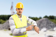 Construction site manager showing watch as late concept.