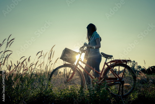 Women relaxing with a bike in nature