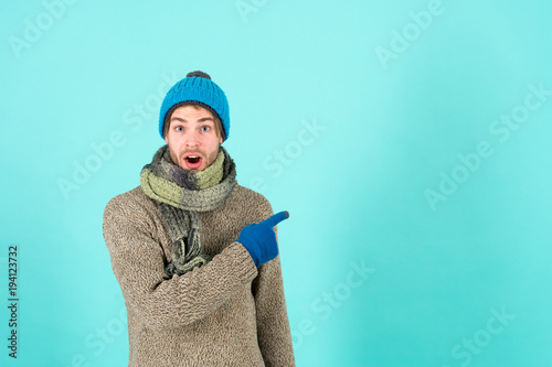 Macho in warm hat, sweater, scarf, fashion