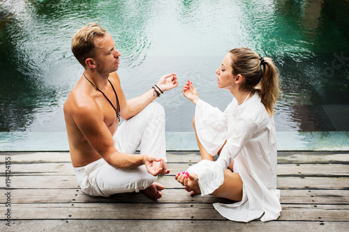 Man and woman meditating together