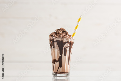 Photo Stands Milkshake Chocolate Milk and Whipped Cream on White Background