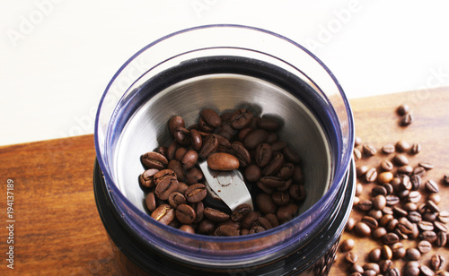 coffee beans in an electric coffee grinder Tableau sur Toile