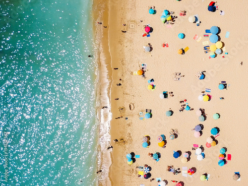 Foto op Aluminium Luchtfoto Aerial View From Flying Drone Of People Crowd Relaxing On Beach In Portugal