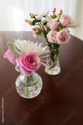 Two crystal vases with roses and miniature flowers & Two crystal vases with roses and miniature flowers - Buy this stock ...
