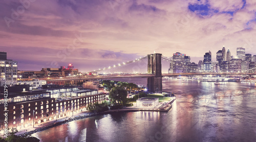 Dumbo neighborhood and the Brooklyn Bridge at night, color toned picture, New York City, USA Wallpaper Mural