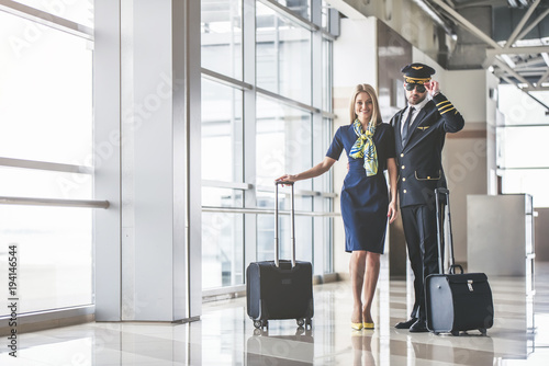 Pilot and flight attendant in airport Canvas Print