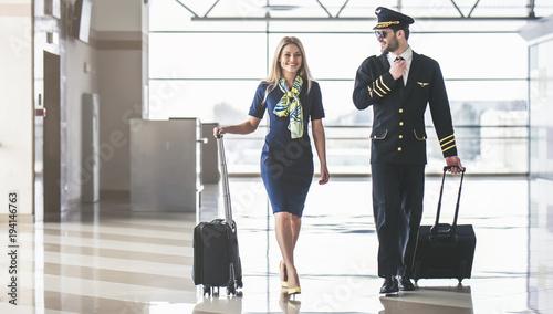 Pilot and flight attendant in airport Wallpaper Mural