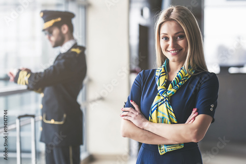 Fotografie, Obraz  Pilot and flight attendant in airport