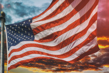 American Flag Flying, Flag USA Over Beautiful Sunset Sunrise With Clouds, In Pink And Purple Shades Pink Sky Sunrise Clouds