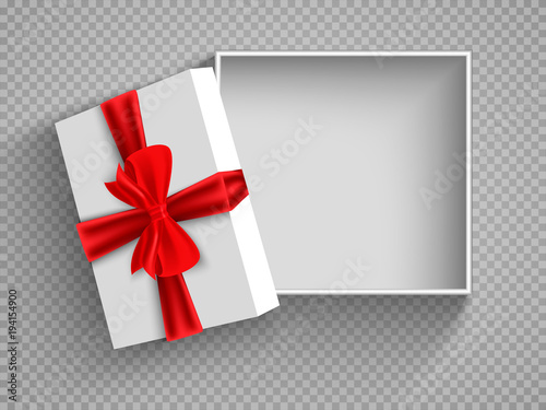 Leinwand Poster Open gift box with red bow isolated on white
