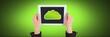 Leinwandbild Motiv Hand holding tablet with cloud icon