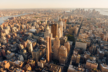 Aerial view at sunset of Manhattan below 30th Street (along 5th Avenue) including Midtown, Flatiron District, Chelsea, East Village, Lower Manhattan and the Financial District