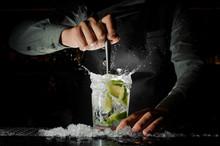 Barman Hand Squeezing Fresh Ju...