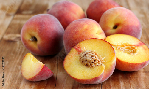Peaches on a wooden table.